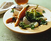 Steamed vegetables with herbs and oil and vinegar sauce
