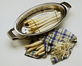 White asparagus stalks in cooking pot