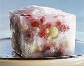 Frozen fruit in a block of ice
