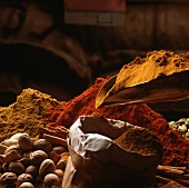 Various spices in a sack and on a scoop