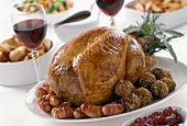 Turkey with raisin balls and bacon rolls