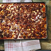 Plum cake with caramel icing on a baking tray