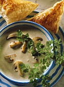 Creamed mushroom soup with chervil, with puff pastry triangles