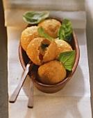 Potato balls with mozzarella and tomato filling