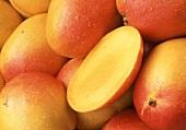 Whole mangoes and half a mango