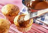 Coating muffins with cake chocolate (couverture)