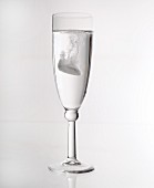 A glass of water with an effervescent tablet