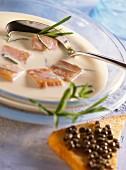 Salmon soup with caviare and tarragon