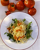 Spaghetti with diced tomatoes and rocket