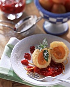 Apricot dumplings with redcurrant sauce