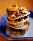 Layered pancakes with nuts and fruit