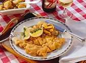 Wiener Schnitzel with lemon wedge & fried potatoes