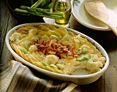 Potato casserole with vegetables and bacon