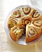 Apple rose cake (coiled bun round) with ginger, piece cut