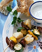 Fish and vegetable kebab with yoghurt dip