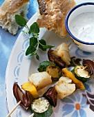 Fish and vegetable kebab with yoghurt dip
