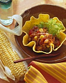 Taco shells with tomato and bean filling