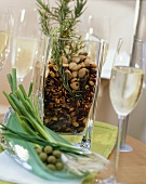 Roasted nuts with herbs in a glass