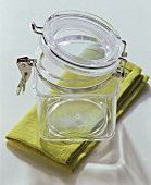 An empty preserving jar on green napkin