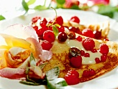Pancake with berries and vanilla mousse