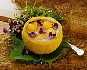 Cold melon soup with pansies in melon half