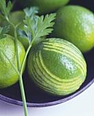 Limes, one peeled decoratively