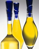 Olive oil in three decorative bottles