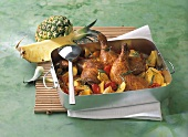 Chicken leg with pineapple in a roasting dish