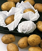 New potatoes in baking paper