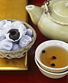 Indian tea with berries, with tea nests behind