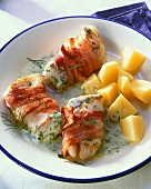 Ling fillet wrapped in bacon with herb cream sauce