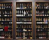 Several champagne bottles on sales shelves