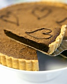 Chocolate tart, one piece on cake slice