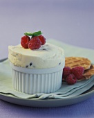 Vanilla and blueberry ice cream souffle, with raspberries