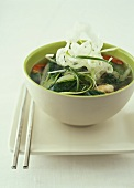 Asian soup with pak choi and deep-fried glass noodles