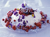 Mascarpone mousse with mixed berries and edible flowers