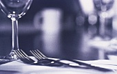 Two forks and a glass (black and white photo)