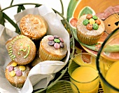 Lemon muffins with coloured chocolate buttons