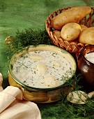 Cold potato soup with sour cream and dill
