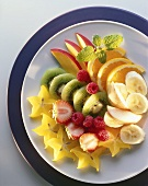Slices of fruit and berries on plate