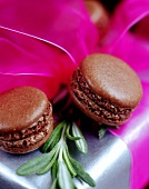 Filled chocolate macaroons on gift box