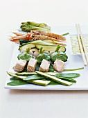 Ingredients for tempura (vegetables, fish, scampi, batter)