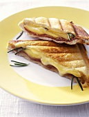 Toast triangles with ham and cheese filling