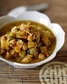 Pumpkin and chick pea stew with pieces of bacon