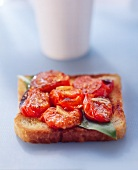 A slice of toast with tomatoes (bruschetta)