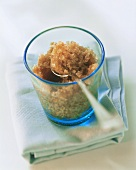 Coffee granita with spoon in glass