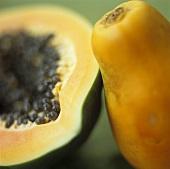 A whole papaya and half a papaya
