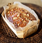 Pecan nut cake in a wooden dish