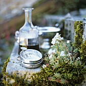 Red wine in carafe, silver tastevins (tasting dishes) in front