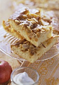 Apple cake with flaked almonds, in slices